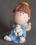 este dulce angelito sentadito es perfecto como souvenir en juego con el adorno para la torta